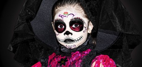 Child dressed up for Dia de los Muertos